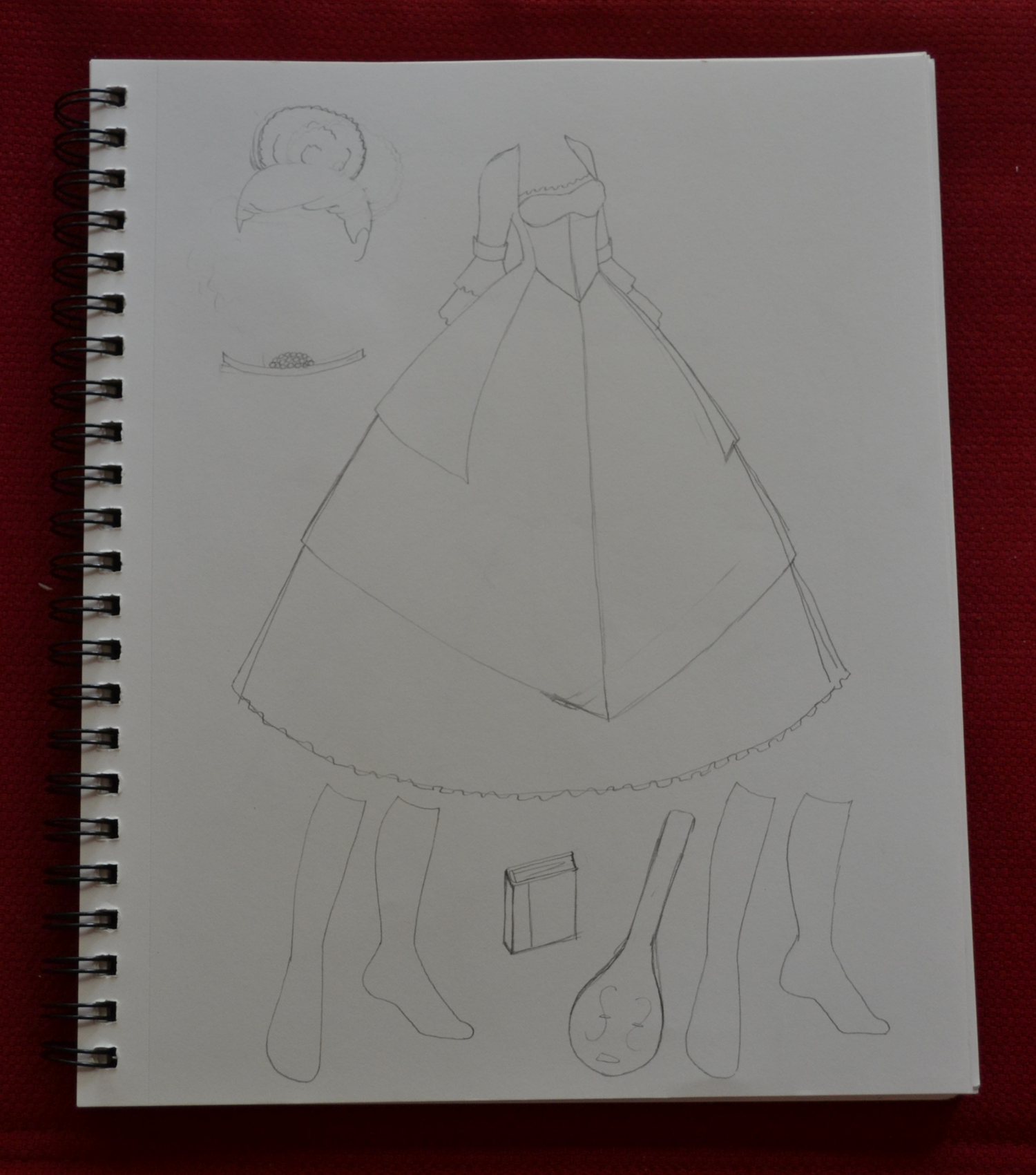A rough pencil sketch of a future paper doll set featuring a full skirted princess gown, shoes, tiara and wig.