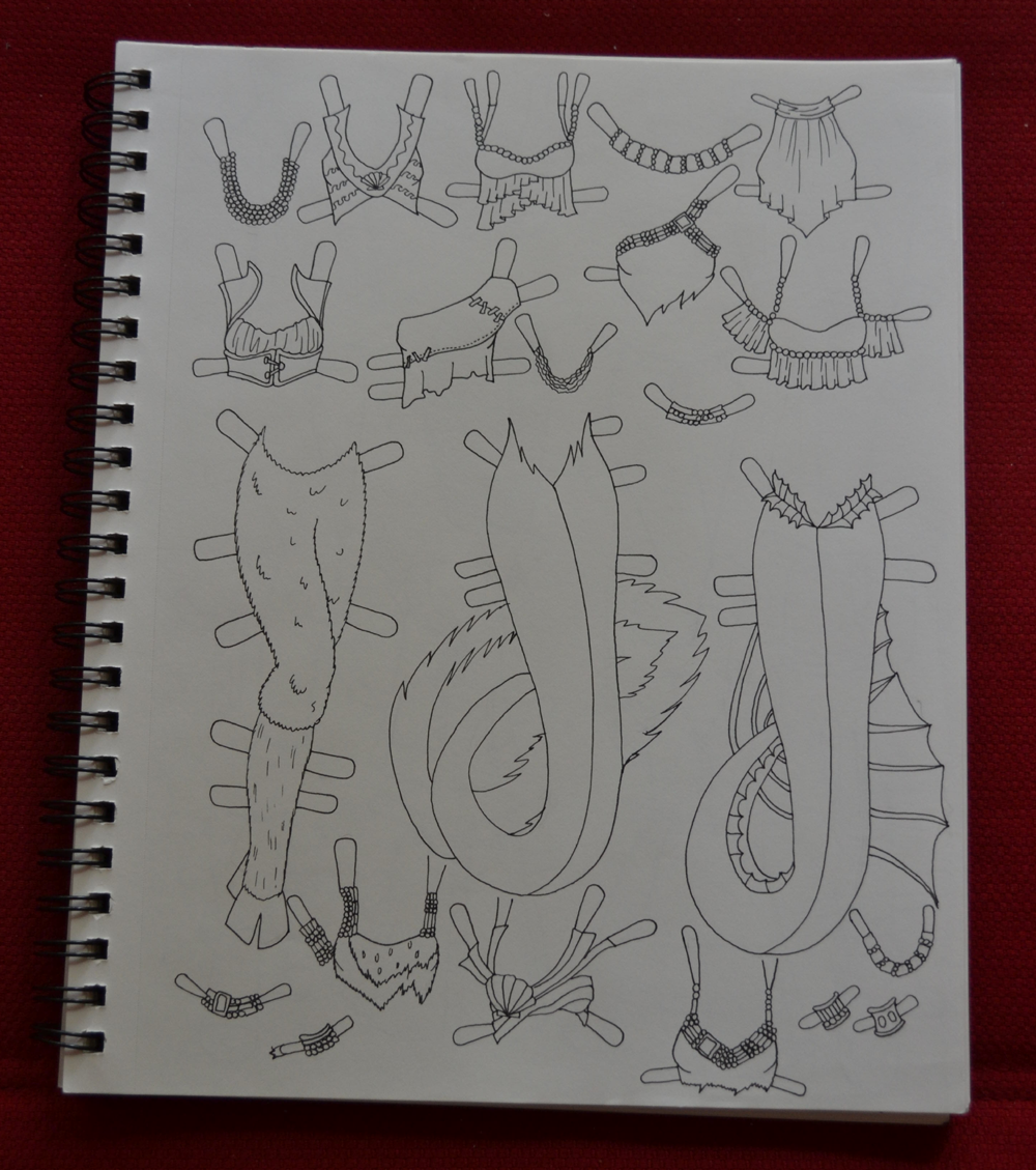 A photograph of my sketchbook on a red background which mermaid and female faun outfit pieces for the Mini-Maidens Series.