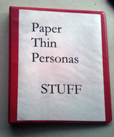 The red binder is home to all important blog documents.