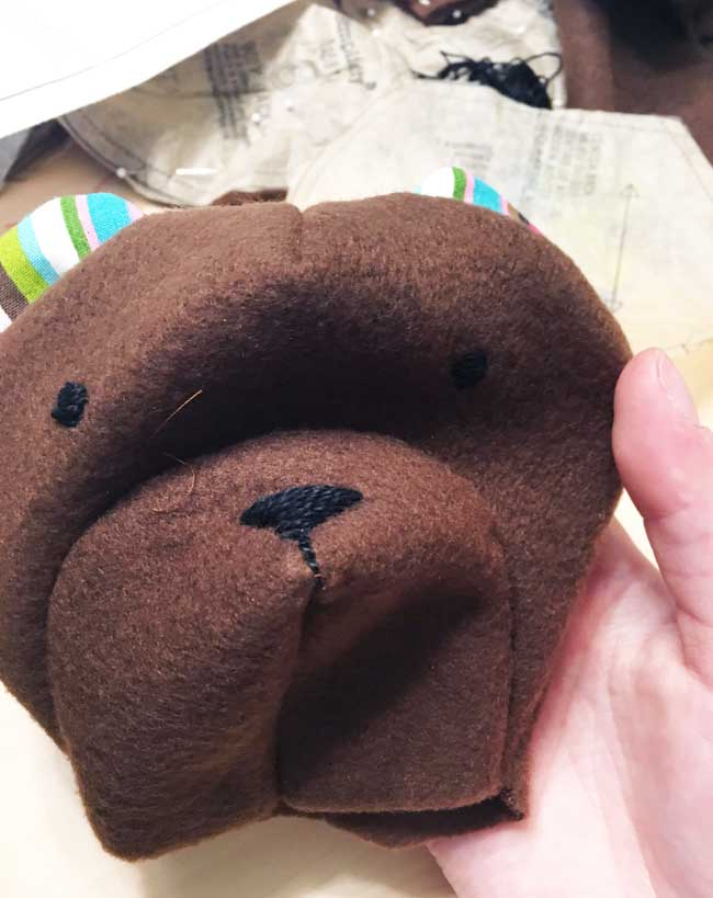 A photograph of the embroidery on the face of my teddy bear head.